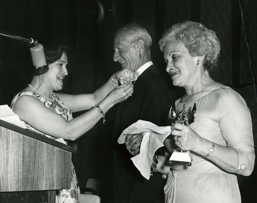 Flori and Myer Brown accepting an award (and corsage) from Shirley Kort at the first NCJW Angels Ball June 16, 1962, (L.20604).