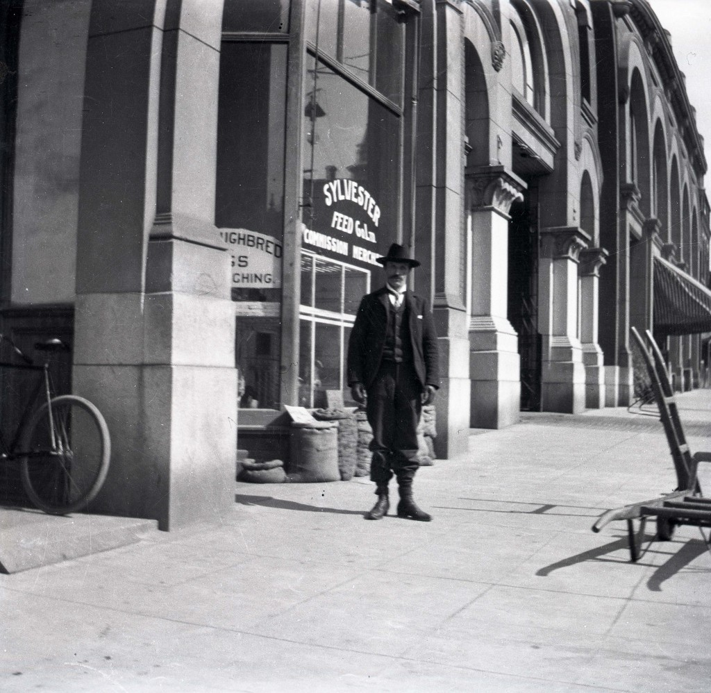 Unidentified man outside Sylvester's store (L.18529).